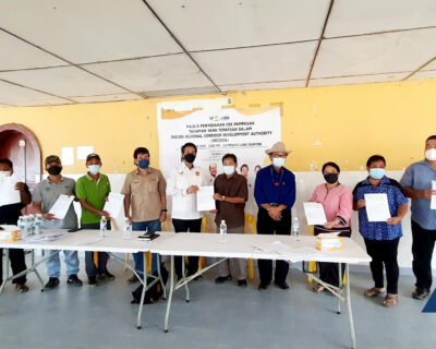 HDA Crop Compensation Cheques for residents in Long Banyok