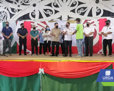 Cheque compensation ceremony by YB Tuan Kennedy Chukpai Ugon